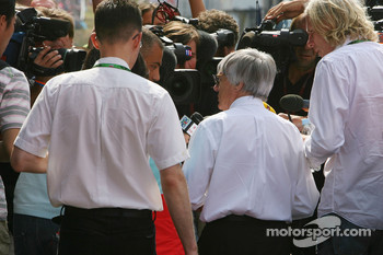 Bernie Ecclestone talks with the media