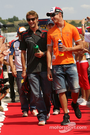 Adrian Sutil, Spyker F1 Team and Jenson Button, Honda Racing F1 Team