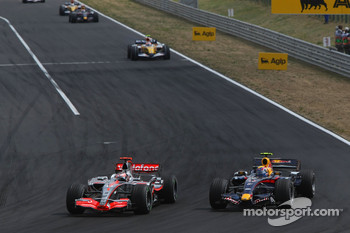 Fernando Alonso, McLaren Mercedes, MP4-22 passes Mark Webber, Red Bull Racing, RB3