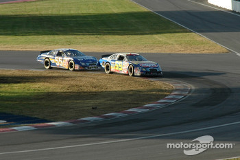 Marcos Ambrose and Robby Gordon battle