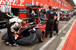 Last-minute shampoo for # 14 Minardi Team USA of Robert Doornboss