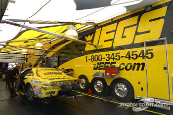 Crew works on Jeg Coughlin Jr's. car Friday morning