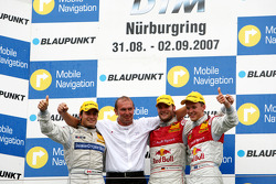 Podium: race winner Martin Tomczyk, second place Mattias Ekström, third place Bruno Spengler