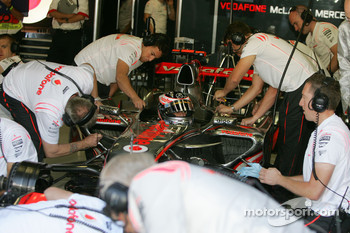 Fernando Alonso, McLaren Mercedes surrounded by team members