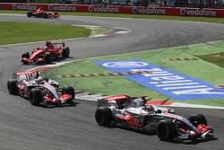 Fernando Alonso, McLaren Mercedes, MP4-22 leads Lewis Hamilton, McLaren Mercedes, MP4-22 and Felipe Massa, Scuderia Ferrari, F2007