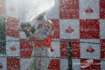 Podium: champagne for Lewis Hamilton