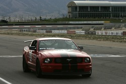 Mario Andretti drives a Ford Mustang around Miller Motorsports Park
