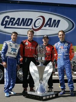 Grand Am Rolex Series 2007 championship contenders Scott Pruett, Alex Gurney, Jon Fogarty and Max Angelelli pose with the championship trophy