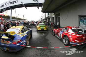 The top-three finishing cars in parc ferm