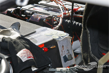 Carl Edwards' dashboard has a four leaf clover from a young fan and a picture of another young fan