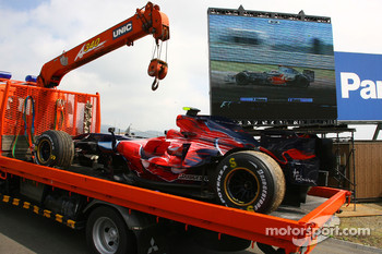 The car of Sebastian Vettel, Scuderia Toro Rosso, STR02 is returned to the pitlane after stopping on track