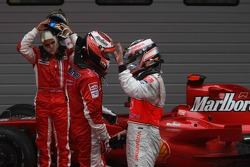 Felipe Massa, Scuderia Ferrari with 2nd place Fernando Alonso, McLaren Mercedes and 1st place Kimi Raikkonen, Scuderia Ferrari