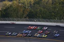 Last lap: Jimmie Johnson leads Jeff Gordon in turn 1
