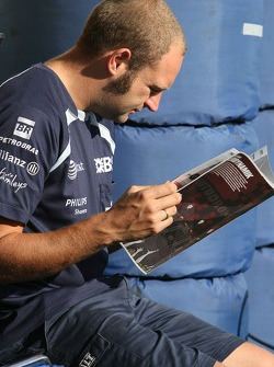 A Williams F1 Team member reading the Red Bulletin