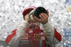 Podium: champagne for Kimi Raikkonen