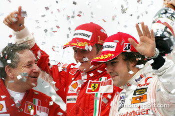 Podium: race winner and 2007 World Champion Kimi Raikkonen, third place Fernando Alonso, and Jean Todt