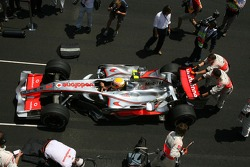 Lewis Hamilton, McLaren Mercedes gets pushed into his grid slot