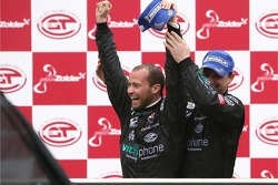 GT1 podium: FIA GT1 drivers 2007 champion Thomas Biagi celebrates with Michael Bartels