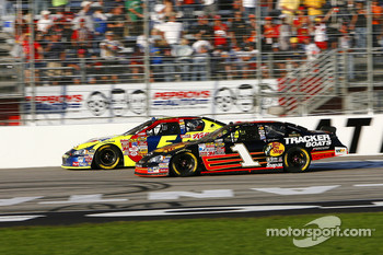 Martin Truex Jr. fights for the lead with Kyle Busch