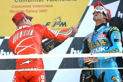 Podium: champagne for Casey Stoner and John Hopkins