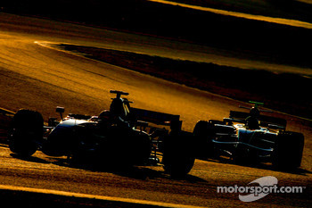 Kimi Raikkonen, Scuderia Ferrari, F2007 and Mark Webber, Red Bull Racing, RB3