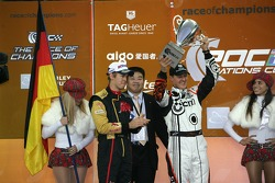 Sebastian Vettel and Michael Schumacher lift the Nations Cup for Germany