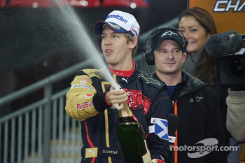 Sebastian Vettel sprays the champagne on the podium