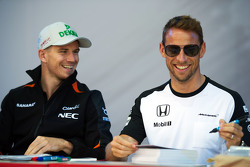 (L to R): Nico Hulkenberg, Sahara Force India F1 with Jenson Button, McLaren
