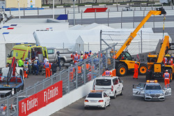 Carlos Sainz Jr., Scuderia Toro Rosso STR10 is extracted from the barriers after he crashed in the third practice session