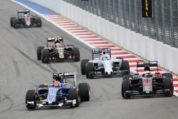 Felipe Nasr, Sauber C34 and Jenson Button, McLaren MP4-30