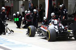 Jenson Button, McLaren MP4-30 makes a pit stop