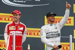 (L to R): second placed Sebastian Vettel, Ferrari with race winner Lewis Hamilton, Mercedes AMG F1 on the podium
