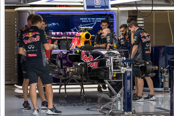 A Red Bull Racing RB11 is prepared in the pits
