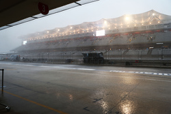 The Mercedes AMG F1 pit gantry takes a battering during a thunderstorm that cancelled FP2