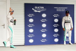 Polesitter Nico Rosberg, Mercedes AMG F1 in parc ferme with second place team mate Lewis Hamilton, Mercedes AMG F1,