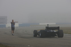 Oriol Servia heads to track first as the fog clears out