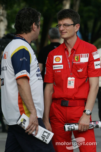 Chris Dyer, Scuderia Ferrari, Track Engineer of Kimi Raikkonen with a Renault F1 Team member