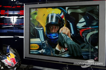Mark Webber, Red Bull Racing on a monitor in the garage