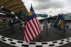 Grid girl with the Malaysian Flag