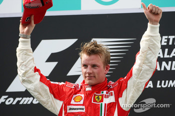 Podium: race winner Kimi Raikkonen celebrates