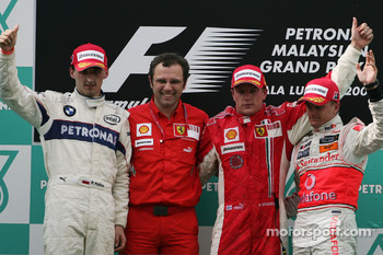Podium: race winner Kimi Raikkonen, second place Robert Kubica, third place Heikki Kovalainen, Stefano Domenicali, Scuderia Ferrari, Sporting Director