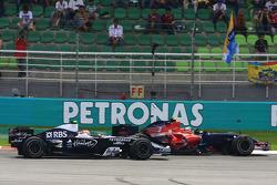 Sebastian Vettel (Scuderia Toro Rosso), Kazuki Nakajima (AT&T Williams)