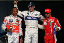 Pole winner Robert Kubica celebrates with Lewis Hamilton and Felipe Massa