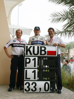 Pole winner Robert Kubica celebrates with Willy Rampf BMW Sauber F1 Techincal Director and Dr. Mario Theissen, BMW Sauber F1 Team, BMW Motorsport Director