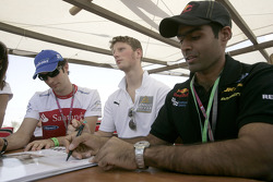 Karun Chandhok Romain Grosjean and Bruno Senna at the GP2 autograph signing session