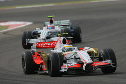 Giancarlo Fisichella, Force India F1 Team, VJM-01 leads Rubens Barrichello, Honda Racing F1 Team, RA108