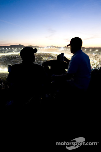 Race fans enjoy the beautiful sunset while watching Nascar Sprint Cup race Subway Fresh Fit 500
