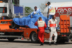Bridgestone and McLaren Mercedes team member inspect the crash damaged car of Heikki Kovalainen, McLaren Mercedes