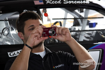 Reed Sorenson takes a snap shoot of fans while they take a picture of him