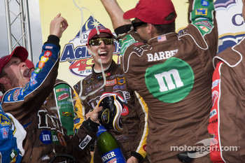 Victory lane: race winner Kyle Busch sprays champagne